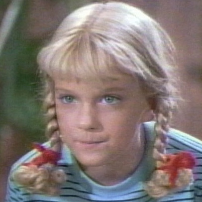 Cindy from the Brady Bunch, in the early days. The youngest one in curls.