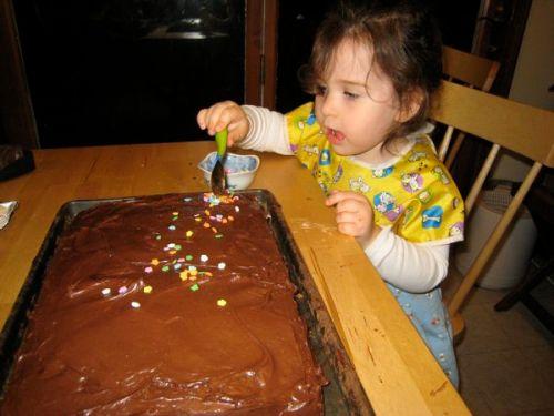 Phoebe sprinkles on the sprinkles.