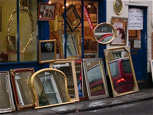 Mirrors outside a frame shop in Bath, England.