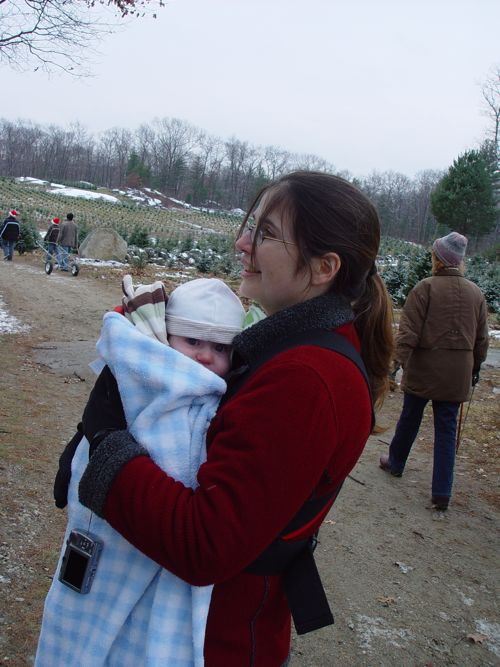 Me with Theo bundled in the bjorn and a blanket. (Photo taken by my mother.)