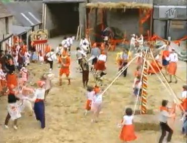 Dancing 'round the maypole in the video for Safety Dance by Men Without Pants. I mean Hats.